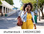 happy young woman in casual... | Shutterstock . vector #1402441280