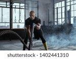 bald athlete doing battle rope...   Shutterstock . vector #1402441310