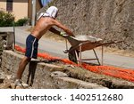 bricklayer making a new wall | Shutterstock . vector #1402512680