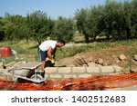bricklayer building a new wall | Shutterstock . vector #1402512683