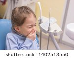 little girl with toothache in... | Shutterstock . vector #1402513550