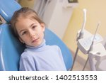 little girl with toothache in... | Shutterstock . vector #1402513553