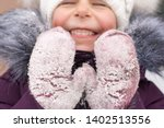 happy child with red cheeks in... | Shutterstock . vector #1402513556