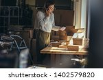 drop shipping business owner... | Shutterstock . vector #1402579820