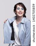portrait of smiling female in...   Shutterstock . vector #1402705859