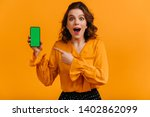 excited woman pointing with... | Shutterstock . vector #1402862099