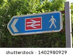 sign indicating the footpath to ... | Shutterstock . vector #1402980929
