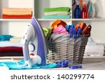clothes and iron on table on... | Shutterstock . vector #140299774