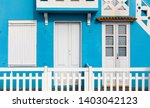 street with colorful houses in... | Shutterstock . vector #1403042123