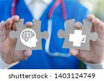 Stock photo mental health concept on a jigsaw pieces in a doctor hands physician holding a puzzles with a 1403124749