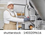 butcher man working on sausage... | Shutterstock . vector #1403209616