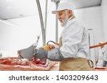 electric knife in meat... | Shutterstock . vector #1403209643