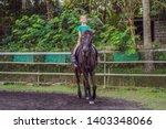 boy horseback riding ... | Shutterstock . vector #1403348066