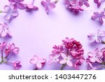 frame made of beautiful lilac... | Shutterstock . vector #1403447276
