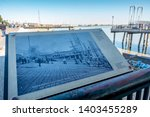 Small photo of New Orleans, USA - Dec 11, 2017: Outdoor commemorative plaque telling the story of Picayune Pier (Lugger's Landing) in 1895. The plaque is located along the shoreline near Toulouse Station.