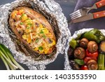 baked potatoes in foil with...