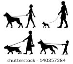 Stock vector editable vector silhouettes of contrasting dogs and owners 140357284