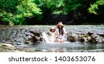 mother and daughter playing in... | Shutterstock . vector #1403653076