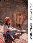 asian woman traveler sitting on ... | Shutterstock . vector #1403691710