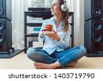 woman drinking coffee and...   Shutterstock . vector #1403719790
