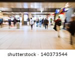 picture in intentional motion blur of walking people in an underpass of a train station - stock photo