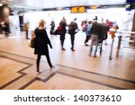 picture in motion blur of traveling people in an underpass of a railway station - stock photo
