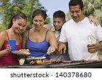 Boy With Family Gathered Aroun...