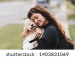 Young Woman Hugging A White...