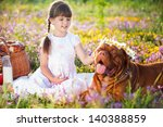 Stock photo young girl with dog on field 140388859