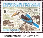 "Small photo of FRENCH TERRITORY OF AFARS AND ISSAS - CIRCA 1967: A stamp printed in France from the ""Fauna"" issue shows a Grey-headed Kingfisher (Halcyon leucocephala) bird, circa 1967."