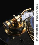 Small photo of gold plated tone arm on turntable
