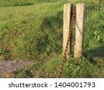 rusty metal chain blocking... | Shutterstock . vector #1404001793
