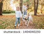 happy beautiful family with dog ... | Shutterstock . vector #1404040250