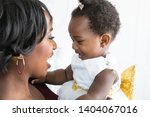 Stock photo mother and daughter laughing and playing 1404067016