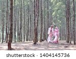 creative outdoor photo shoot of a malay loving couple bride and groom on their wedding wearing a traditional malay dress