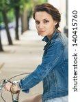 Urban Biking. Young Girl And...