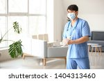male medical assistant in clinic | Shutterstock . vector #1404313460