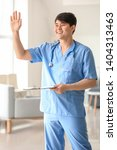 male medical assistant in clinic | Shutterstock . vector #1404313463