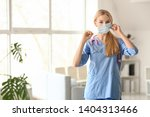 female medical assistant in... | Shutterstock . vector #1404313466
