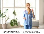 female medical assistant in... | Shutterstock . vector #1404313469