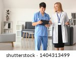 female doctor and male medical... | Shutterstock . vector #1404313499