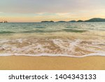 beach sunset or sunrise with... | Shutterstock . vector #1404343133