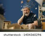 Small photo of Drown image of losing of mind. Old bearded man with alzheimer desease sitting and suffering from headache. Illness, memory loss due to dementia, healthcare, neurological disorder, depression.