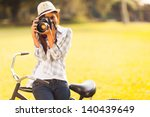 Smiling Young Woman Using A...