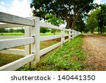 White Concrete Fence In Farm...