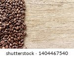 flame with coffee beans on old... | Shutterstock . vector #1404467540