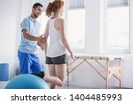 physiotherapist supporting... | Shutterstock . vector #1404485993