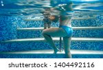 underwater image of young... | Shutterstock . vector #1404492116