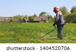 elderly farmer in an orange... | Shutterstock . vector #1404520706