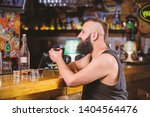 hipster brutal man drinking... | Shutterstock . vector #1404564476